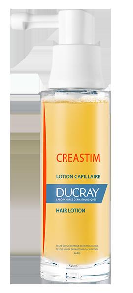 En flaske Creastim lotion mod hårtab